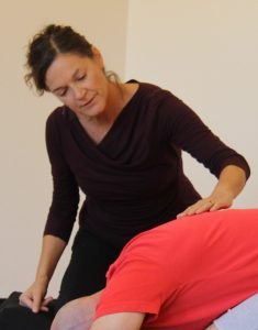 Mary Hilliker, RDN, E-RYT 500, C-IAYT, Certified Viniyoga Teacher & Yoga Therapist working with a client.